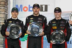 Overall podium: second place Eric Curran, Dane Cameron, Scott Pruett, Action Express Racing