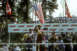 Podium: winner Eddie Lawson, second place Freddie Spencer, third place Randy Mamola