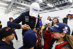 Esteban Ocon, Force India, signs autographs for kids
