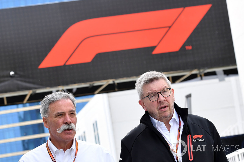 Chase Carey, Chief Executive Officer and Executive Chairman of the Formula One Group and Ross Brawn,
