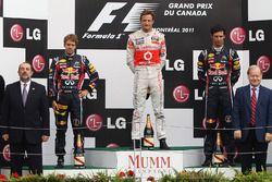 Podium: race winner Jenson Button, McLaren, second place Sebastian Vettel, Red Bull Racing, third place Mark Webber, Red Bull Racing
