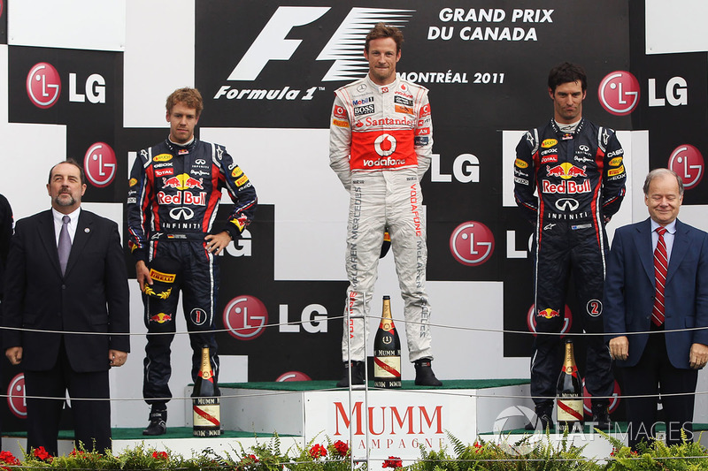 Podium: race winner Jenson Button, McLaren, second place Sebastian Vettel, Red Bull Racing, third place Mark Webber, Red Bull Racing