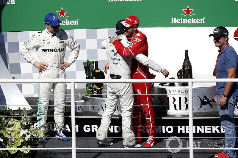 Podium: winner Sebastian Vettel, Ferrari, second place Valtteri Bottas, Mercedes AMG F1, Rubens Barr