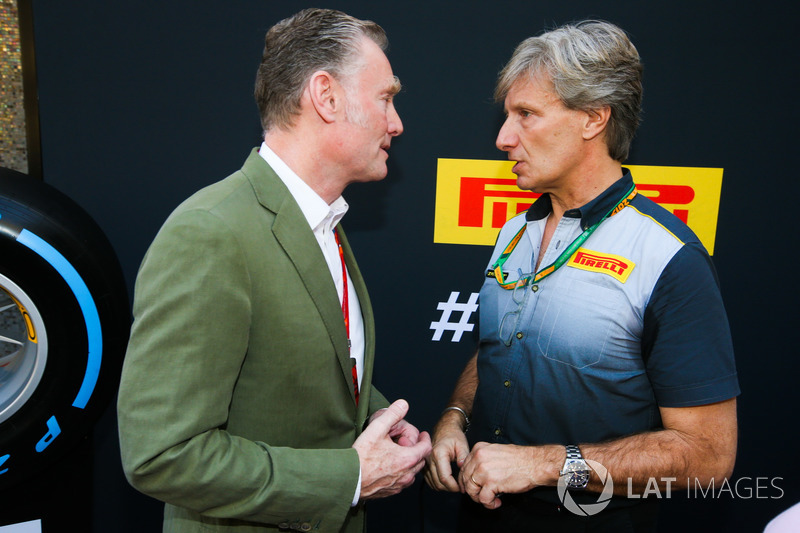 Sean Bratches, Managing Director of Commercial Operations, Formula One Group talks to a Pirelli representative