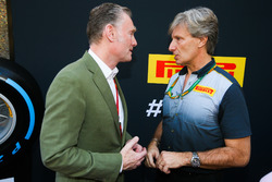 Sean Bratches, Managing Director of Commercial Operations, Formula One Group talks to a Pirelli repr