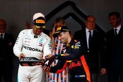 Lewis Hamilton, Mercedes AMG F1, fills the shoe of Daniel Ricciardo, Red Bull Racing with Champagne