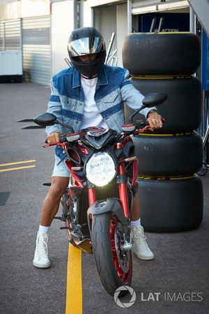 Lewis Hamilton, Mercedes AMG F1, on his motorbike
