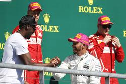 Race winner Lewis Hamilton, Mercedes AMG F1, second place Sebastian Vettel, Ferrari, third place Kimi Raikkonen, Ferrari, with Usain Bolt