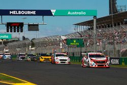 Garth Tander, Garry Rogers Motorsport Holden, leads Will Davison, 23Red Racing Ford, and Tim Slade,