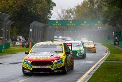 Chaz Mostert, Tickford Racing Ford, leads Mark Winterbottom, Tickford Racing Ford, and Tim Slade, Brad Jones Racing Holden