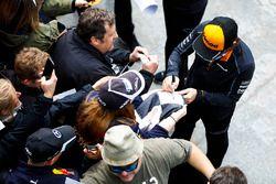 Fernando Alonso, McLaren, signs autographs for fans