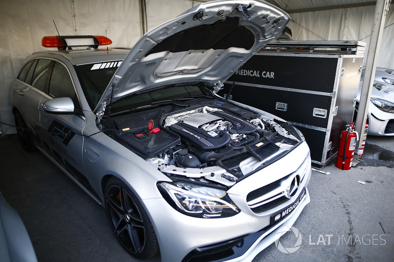 An AMG Mercedes medical car is parked with its bonnet raised