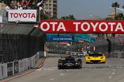 #5 Action Express Racing Cadillac DPi, P: Joao Barbosa, Filipe Albuquerque, #4 Corvette Racing Chevrolet Corvette C7.R, GTLM: Oliver Gavin, Tommy Milner take the checkered flag and win