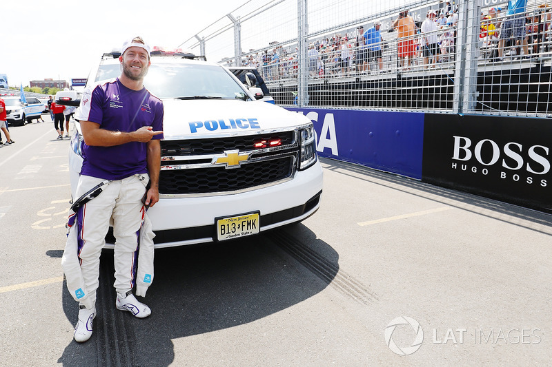 Sam Bird, DS Virgin Racing, poses for a picture with a police vehicle
