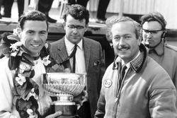Race winner Jim Clark, Lotus, receives the winners trophy with team boss, Colin Chapman on the podiu