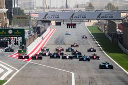 Lando Norris, Carlin, leads Sergio Sette Camara, Carlin and the rest of the field at the start of th