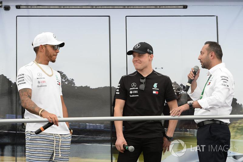 Lewis Hamilton, Mercedes-AMG F1 and Valtteri Bottas, Mercedes-AMG F1 on stage