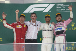Kimi Raikkonen, Ferrari, 2nd position, the Mercedes Constructors delegate, Lewis Hamilton, Mercedes AMG F1, 1st position, and Sergio Perez, Force India, 3rd position, on the podium