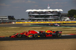 Kimi Raikkonen, Ferrari SH71H and Max Verstappen, Red Bull Racing RB14