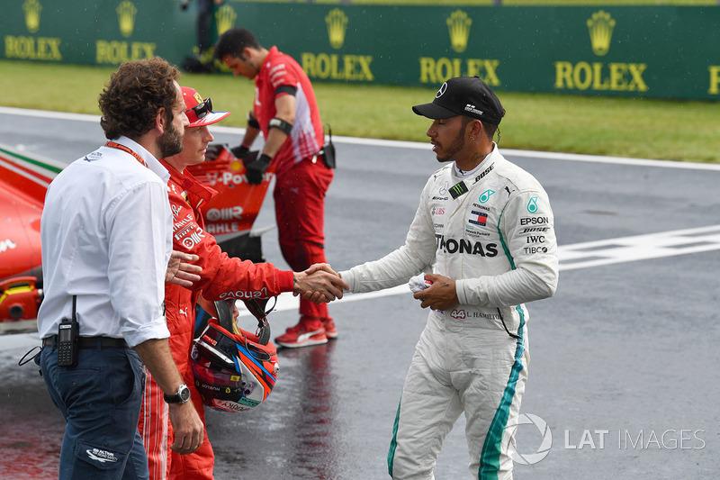 Kimi Raikkonen, Ferrari and Lewis Hamilton, Mercedes-AMG F1 celebrate in parc ferme