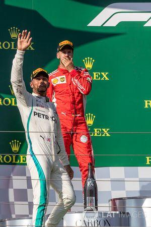 Lewis Hamilton, Mercedes-AMG F1 and Sebastian Vettel, Ferrari celebrate on the podium
