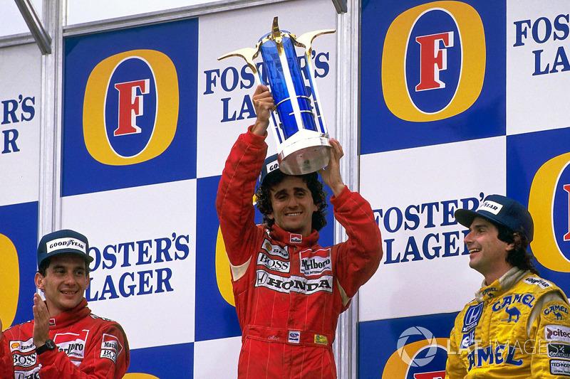 Podium: race winner Alain Prost, McLaren, second place Ayrton Senna, McLaren, third place Nelson Piq