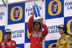 Podium: race winner Alain Prost, McLaren, second place Ayrton Senna, McLaren, third place Nelson Piq
