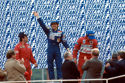 Podium: race winner Alain Prost, Renault, second place Patrick Tambay, Ferrari, third place Eddie Cheever, Renault