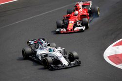 Felipe Massa, Williams FW40 and Sebastian Vettel, Ferrari SF70H battle