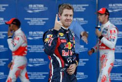 Sebastian Vettel, Red Bull Racing RB7 Renault, celebrates pole
