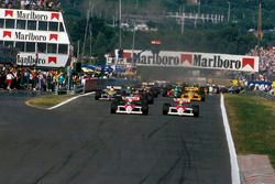 Alain Prost, McLaren MP4/4 leads teammate Ayrton Senna, McLaren MP4/4 and Ivan Capelli, March 881 at