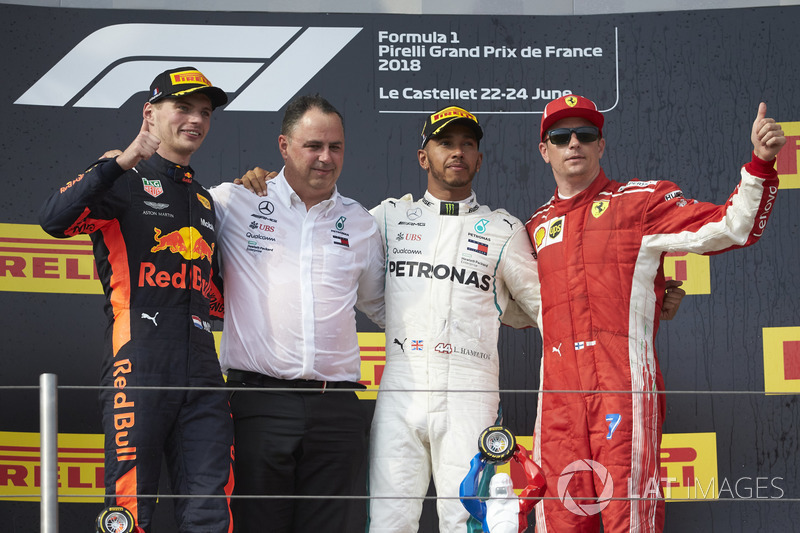 Max Verstappen, Red Bull Racing, 2nd position, Ron Meadows, Sporting Director, Mercedes AMG, Lewis Hamilton, Mercedes AMG F1, 1st position, and Kimi Raikkonen, Ferrari, 3rd position, on the podium