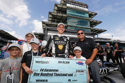 Verizon P1 Pole Award winner Ed Carpenter, Ed Carpenter Racing Chevrolet is presented with the 00,000 check presented to the pole winner