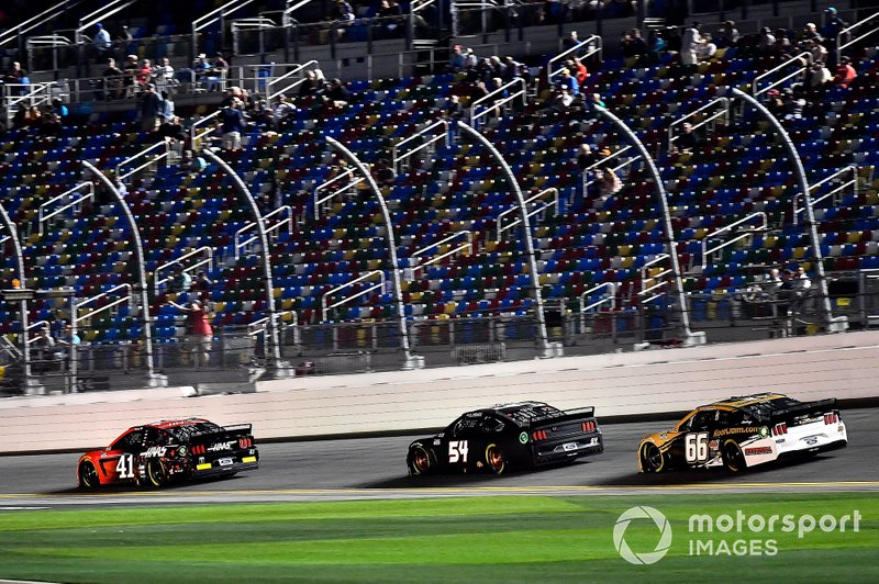 Cole Custer, Stewart-Haas Racing, Ford Mustang Haas Automation leads J.J. Yeley, Rick Ware Racing, Ford Mustang, and Timmy Hill, Motorsports Business Management, Ford Mustang RoofClaim.com/VSI Racing