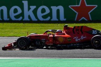 Charles Leclerc, Ferrari SF90, trails sparks from his damaged front wing after contact with Max Verstappen, Red Bull Racing RB15, on the opening lap