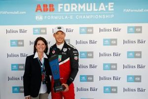 Pole sitter Andre Lotterer, Tag Heuer Porsche, Porsche 99x Electric is presented the pole award by a Julius Bar representative