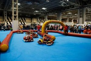 Young fans enjoy some go-karting at the Autosport show
