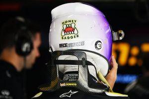 """Helmet detail of Daniel Ricciardo, Renault F1, including a """"Honey Badger"""" sticker"""