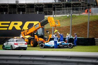 Car of Robert Kubica, Williams FW42 being recovered after crashing