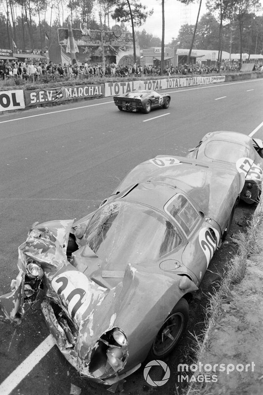 Bruce McLaren, Chris Amon, Shelby American Inc., Ford Mk II, passes the wreckage of Ludovico Scarfiotti, Mike Parkes' SpA Ferrari SEFAC, Ferrari 330 P3, and Georges Heligouin, Jean Rives' S.E.C. Automobiles C.D., C.D. SP66 Peugeot 204