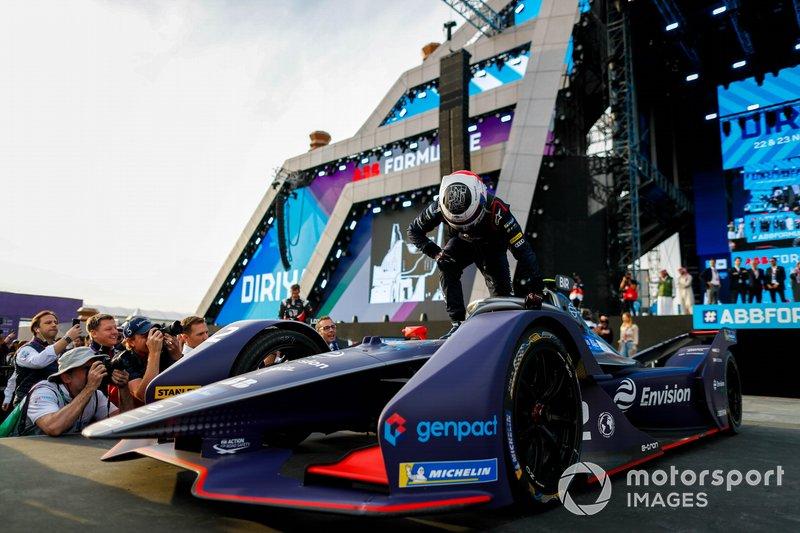 Race winner Sam Bird, Virgin Racing, Audi e-tron FE06 climbs out of his car on the podium