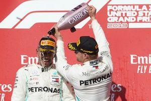 World champion Lewis Hamilton, Mercedes AMG F1, celebrates on the podium with Valtteri Bottas, Mercedes AMG F1