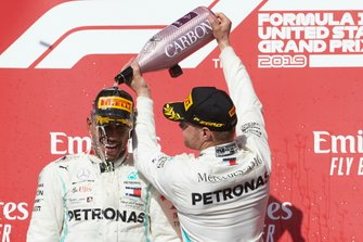 World champion Lewis Hamilton, Mercedes AMG F1, celebrates on the podium with Valtteri Bottas, Mercedes AMG F1