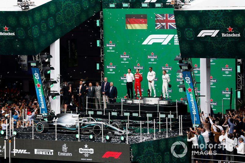 Sebastian Vettel, Ferrari, 2nd position, Lewis Hamilton, Mercedes AMG F1, 1st position, and Valtteri Bottas, Mercedes AMG F1, 3rd position, on the podium