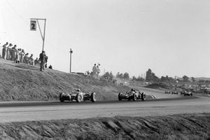 Stirling Moss, Lotus 18 Climax, leads Dan Gurney, BRM P48