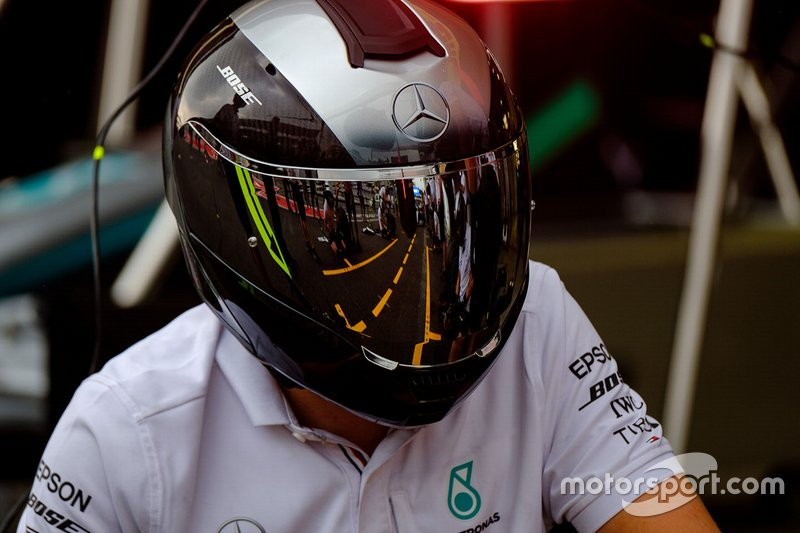 Mercedes AMG F1 mechanic helmet reflection