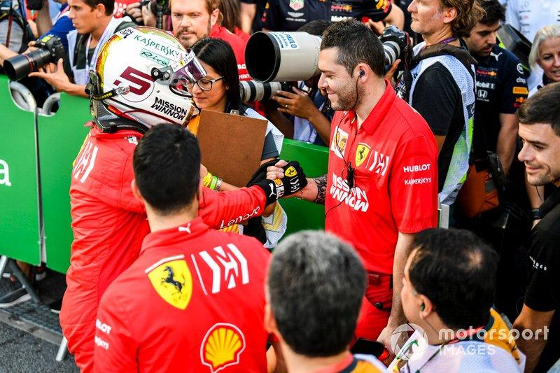 Sebastian Vettel, Ferrari, congratulates his team after Qualifying on the front row