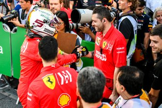 Sebastian Vettel, Ferrari, congratulates his team after Qualifying on the front row