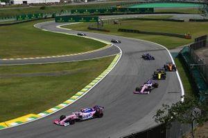 Lance Stroll, Racing Point RP19, leads Sergio Perez, Racing Point RP19, Nico Hulkenberg, Renault F1 Team R.S. 19, Carlos Sainz Jr., McLaren MCL34, and Daniil Kvyat, Toro Rosso STR14
