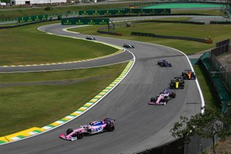 Lance Stroll, Racing Point RP19, leads Sergio Perez, Racing Point RP19, Nico Hulkenberg, Renault F1 Team R.S. 19, Carlos Sainz Jr., McLaren MCL34, and Daniil Kvyat, Toro Rosso STR14